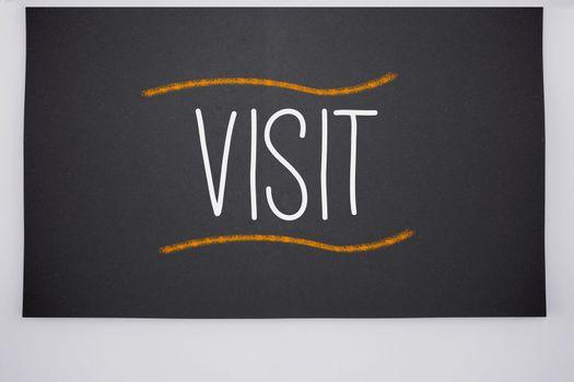 Visit written on big blackboard