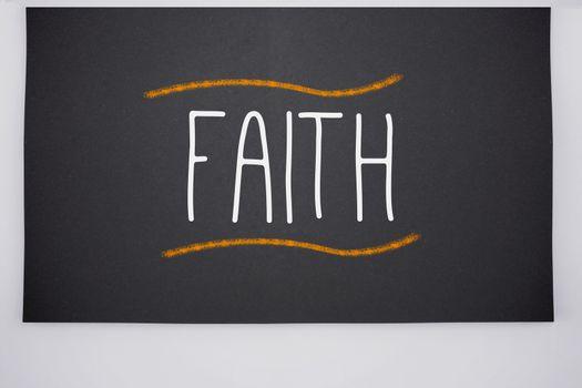 Faith written on big blackboard