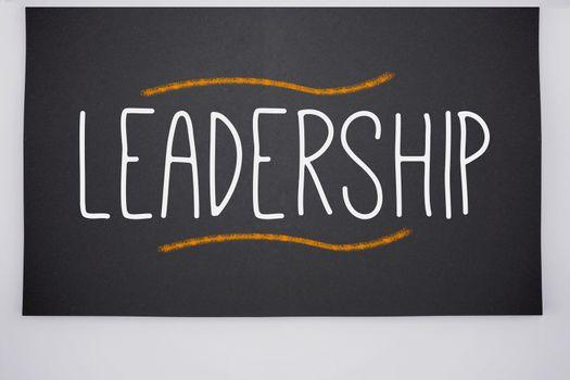 Leadership written on big blackboard