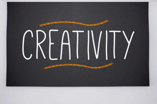 Creativity written on big blackboard