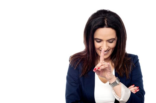Businesswoman smiling with shy