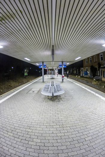 empty railway station early morning in the dark