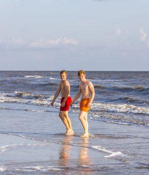 teenager enjoys jogging along the beautiful beach