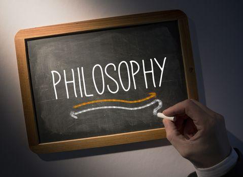 Hand writing Philosophy on chalkboard