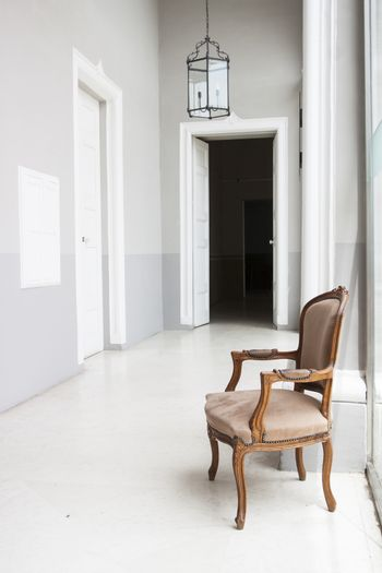 Detail of a corridor in a noble house in Malta with an armchair