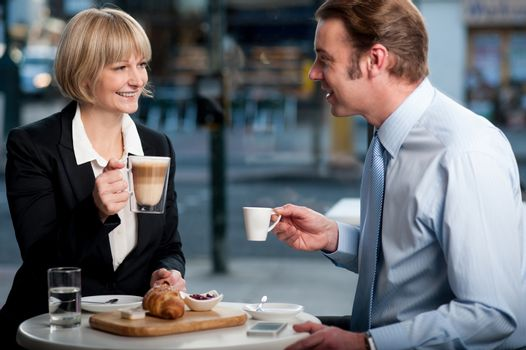 Corporate people toasting coffee at cafe