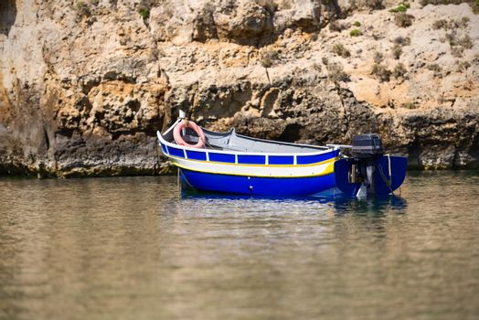 Blue boat with outboard engine at Gozo Malta