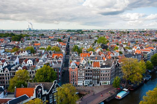 View of Amsterdam from  a church tower with tipical houses and canal in forefront