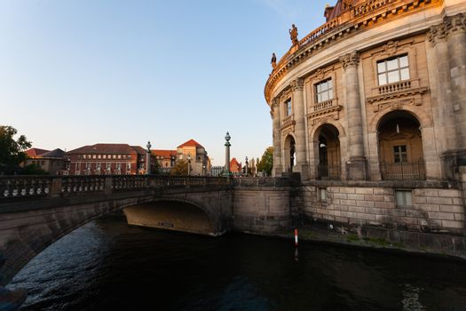City scape of Mitte distrit in Berlin with a stoned bridge over Spree river and Bodemuseum building on the right, Germany