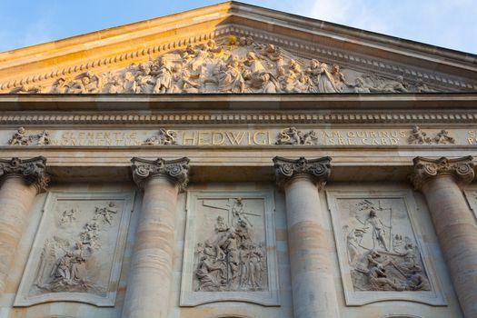 St. Hedwig's Cathedral closeup view of columns ,haut-reliefs and frieze in Berlin Bebelplatz, Germany