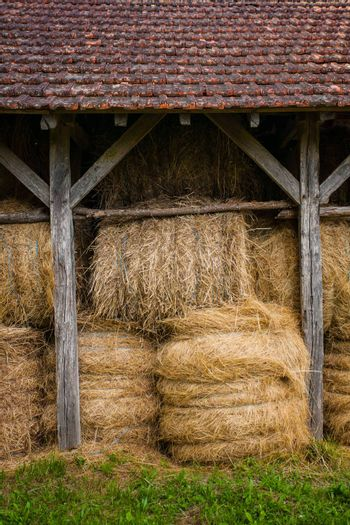 Bundled straw in a hayloft located in the region of Dordogne in France