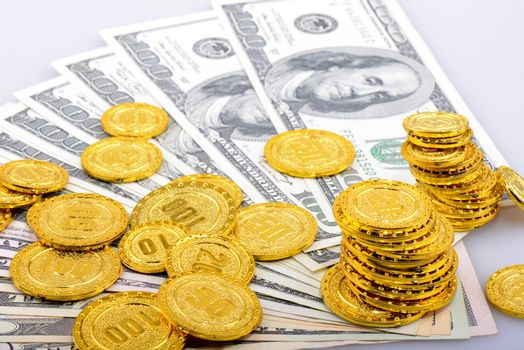 gold coins and dollar banknotes