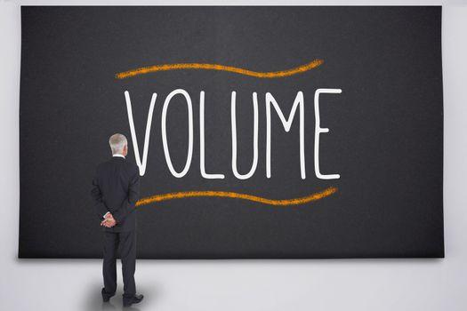 Businessman reading the word volume