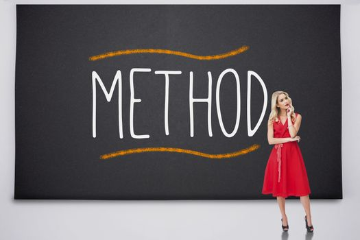 Pretty blonde standing against the word method