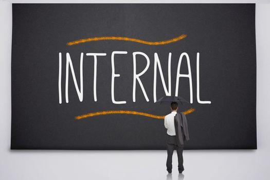 Businessman reading the word internal