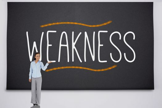 Businesswoman presenting the word weakness