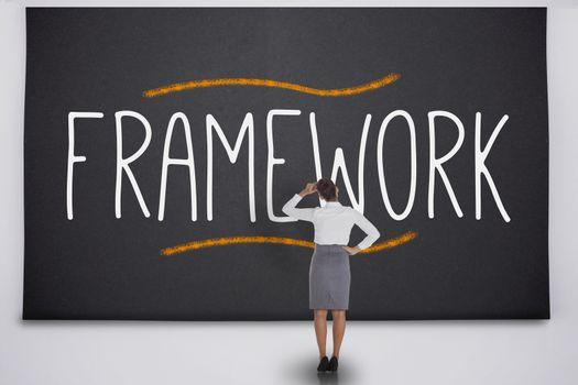 Businesswoman considering the word framework