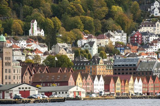 """Bergen, Norway - October 14, 2010; Bergen is """"The Gateway to the Fjords of Norway"""" and a well-established cruise port. Bergen is an international city packed with history and tradition, a big city with small-town charm and atmosphere."""