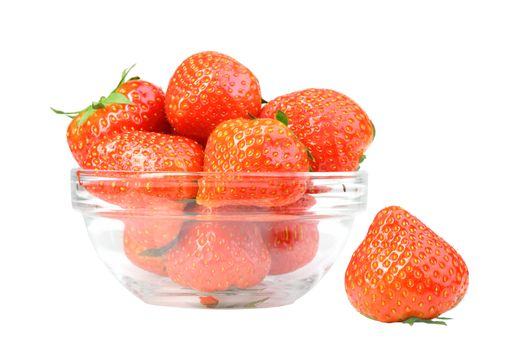 Red strawberries in transparent plate isolated on white