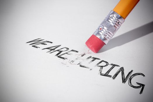Pencil erasing the word We are hiring