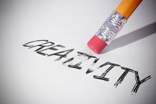 Pencil erasing the word Creativity