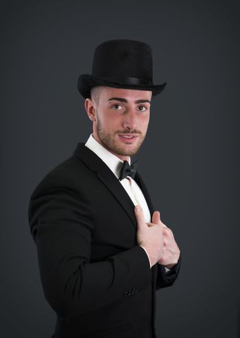 Attractive young businessman with suit, top-hat and bowtie