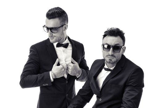 Two elegant men in suit and bowtie isolated