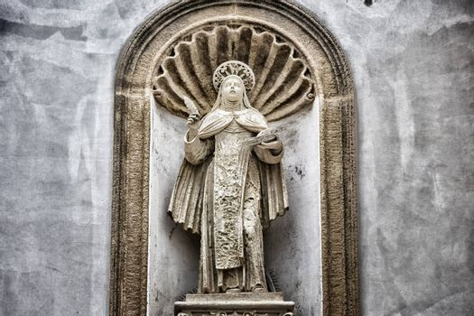 St. Therese of Lisieux statue on the facade of the church and convent of Carmelitane Scalze  in the old town of Gallipoli (Le)
