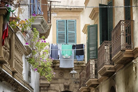 Hanging clothes in Old alley  in the old town of Gallipoli (Le)) in the southern of Italy