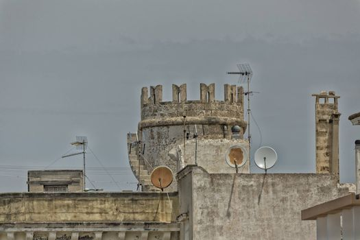 Tower and satellite dishes in the old town of Gallipoli (Le) in the southern of Italy
