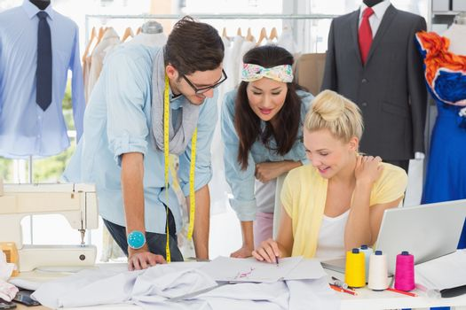 Group of fashion designers at work in a studio