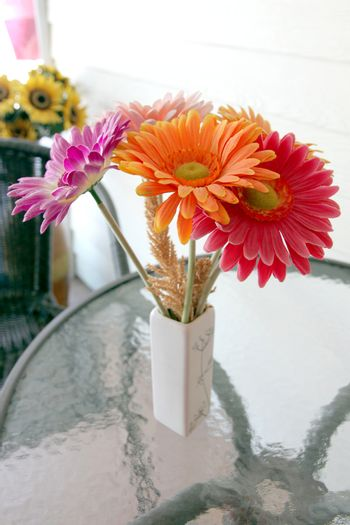 The Picture Colorful flowers in a vase on the table.