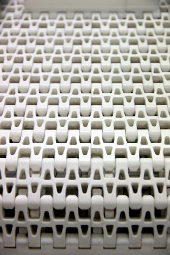Closeup The Picture Patterns of white plastic with a conveyor belt.