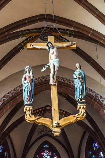 WETZLAR, GERMANY - JULY 3, 2014: beautiful cruzifix and ceiling in the dome  in Wetzlar, Germany.Wetzlar Cathedral has been used by both Roman Catholics and Protestants since the 16th century.