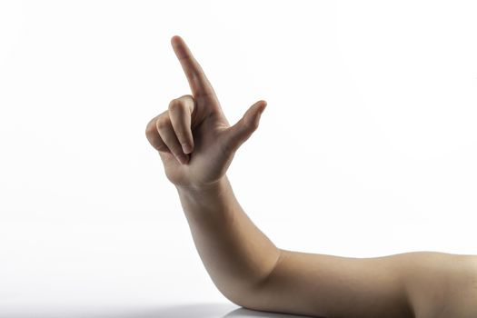 Young hands makes a gesture: number two sign or gun sign