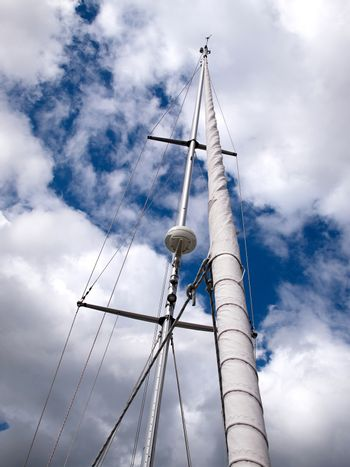 Sails and mast with radar of a modern sail boat boating sailing background