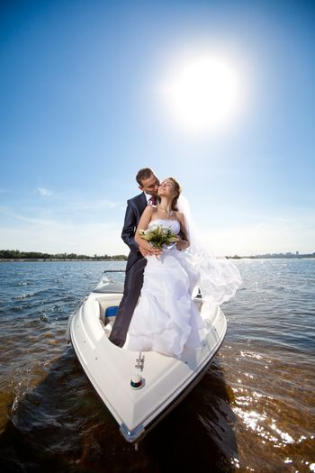 happy young couple on the yacht