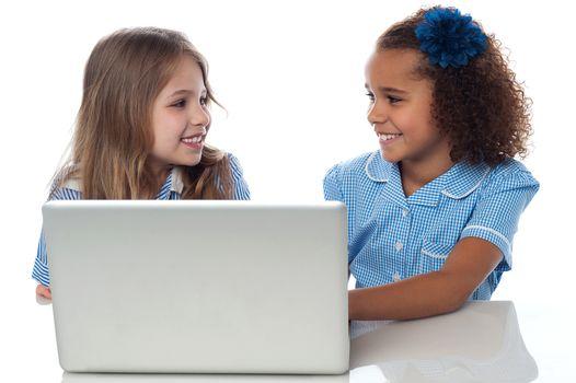 Little girls learning in laptop