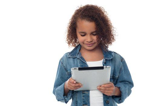 Llittle girl looking digital tablet