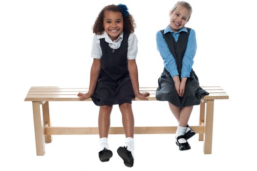 Little girls sitting on the bench