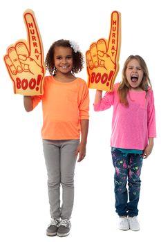 Little girls raises arms with foam finger