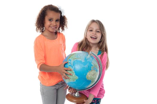 Little girls playing with globe