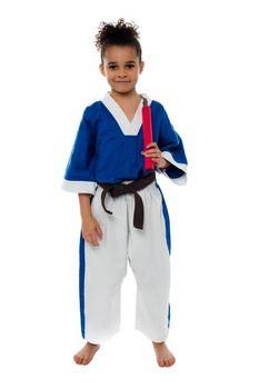 Karate girl holding nunchucks