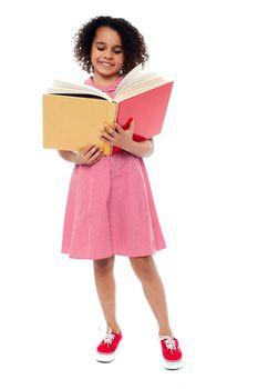 Child preparing for her examinations