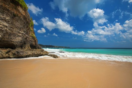 Surf waves and turqoise water along the coast of Bali