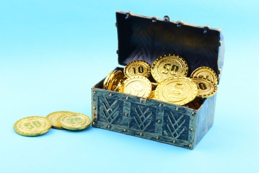 Treasure box with gold coins on a blue background