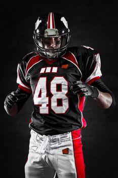 American football player on dark background