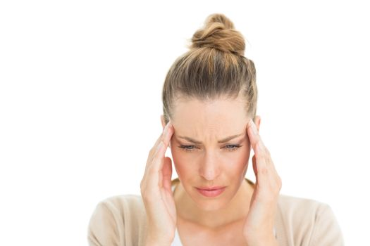 Woman with headache touching her temples