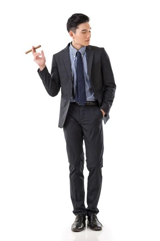 businessman holding a cigar