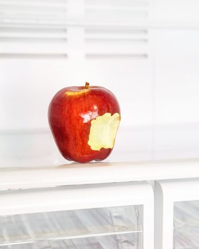 Bitten apple in the fridge